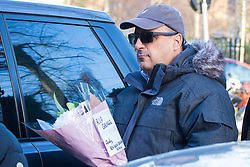 Highgate, London, December 26th 2016. Fans gather outside the London home of pop icon George Michael who died on Christmas day. PICTURED: A man arrives with flowers.