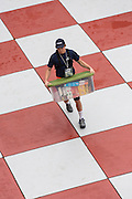 An incoming Citadel freshman known as a knob moves his things into the barracks while avoiding stepping on the red squares during matriculation day on August 17, 2013 in Charleston, South Carolina. The Citadel is a state military college that began in 1843.