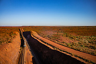 Fully loaded railcars on their way to Port Hedland for export.