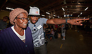 International Oakley athletes join Oakley in helping Mamelodi community members improve their vision by offering free eye testing and prescription eyewear. Mamelodi, Pretoria, South Africa. Images by Greg Beadle