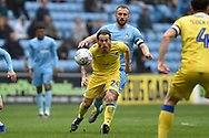 Bristol Rovers midfielder Stuart Sinclair (24) heads the ball during the EFL Sky Bet League 1 match between Coventry City and Bristol Rovers at the Ricoh Arena, Coventry, England on 7 April 2019.