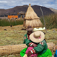 South America, Peru, Uros Islands. Women of the floating reed islands of Lake Titicaca.