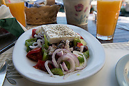 A Greek salad served in a taverna in Loggos on the island of Paxos, The Ionian Islands, The Greek Islands, Greece, Europe