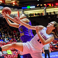 Kirtland Central Bronco Candace Patterson (34) boxes out Los Lunas Tiger Dani Ross (11) for a rebound in a District 5A semifinal at The Pit in Albuquerque Thursday.
