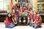 Girl Scouts Troop 910 pose for a photo with the newly re-designed Girl Scouts cookies boxes at the Girl Scouts of Northeast Texas.headquarters in Dallas, Texas, on January 10, 2013.  (Stan Olszewski/The Dallas Morning News)