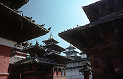 Temple pagodas frame the old palace in Durbar Square. Kathmandu, Nepal. Durbar Square is the plaza opposite the old royal palace in the three main cities in the Kathmandu Valley in Nepal: Kathmandu, Patan and Bhaktapur. The square is filled with temples.