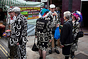Pearly Kings and Queens in the East End of London. Gathering in Brick Lane, and known as pearlies, they are an organised charitable tradition of working class culture in London, England. Today, around 30 Pearly Families continue the tradition to raise money for various charities. Each London Borough has a King and Queen, as do the City of London and the City of Westminster. It's a colourful London tradition and one that has been kept alive by a few dedicated people, who remain figureheads for the capital's working class communities.