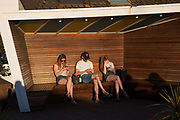 Three young people using mobile phones on the 20th April 2019 in Hastings in the United Kingdom. Hastings is a town on England's southeast coast, its known for the 1066 Battle of Hastings.