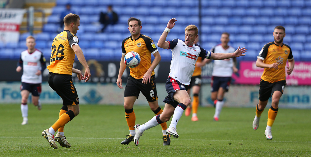 Bolton Wanderers' Eoin Doyle battles with Newport County's Matthew Dolan and Mickey Demetriou<br /> <br /> Photographer Stephen White/CameraSport<br /> <br /> The EFL Sky Bet League Two - Bolton Wanderers v Newport County - Saturday 26th September 2020 - University of Bolton Stadium - Bolton<br /> <br /> World Copyright © 2020 CameraSport. All rights reserved. 43 Linden Ave. Countesthorpe. Leicester. England. LE8 5PG - Tel: +44 (0) 116 277 4147 - admin@camerasport.com - www.camerasport.com