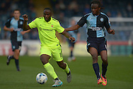 Kudus Oyenuga of Hartlepool United (l)  in action with Marcus Bean of Wycombe Wanderers marking him. Skybet football league two match, Wycombe Wanderers v Hartlepool Utd at Adams Park in High Wycombe, Bucks on Saturday 5th Sept 2015.<br /> pic by John Patrick Fletcher, Andrew Orchard sports photography.