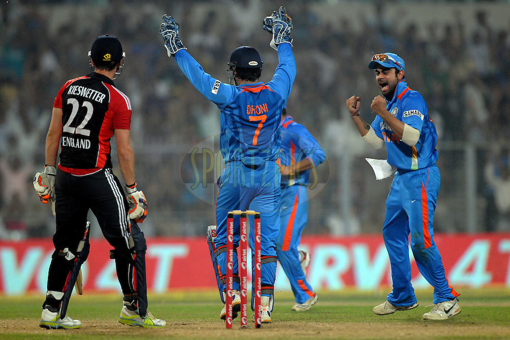 Virat Kohli of India celebrate the wicket of Craig Kieswetter of England during the 5th One Day International ( ODI ) match between India and England held at the Eden Gardens Stadium, Kolkata on the 23rd October 2011..Photo by Pal Pillai/BCCI/SPORTZPICS