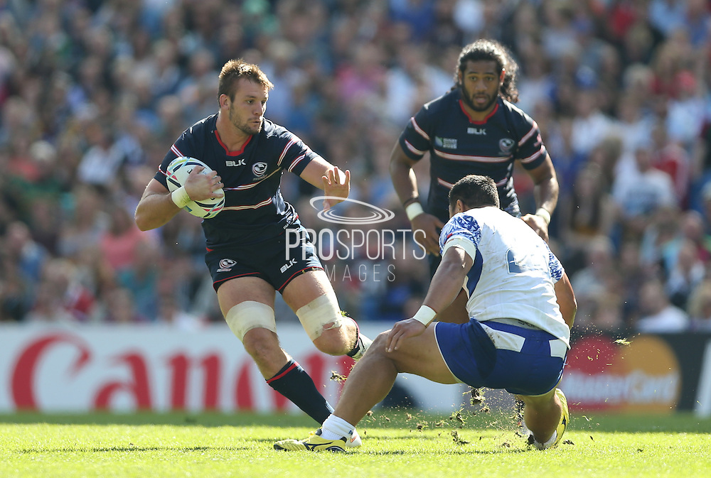 USA Blaine Scully skips a tackle during the Rugby World Cup 2015 match between Samoa and USA at the Brighton Community Stadium, Falmer, United Kingdom on 20 September 2015.