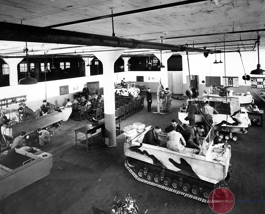 Studebaker engineers work on the World War II Weasel in the Studebaker Engineering Building.