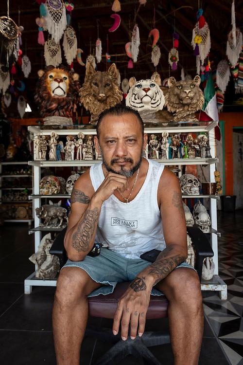 Playa del Carmen, Mexico - May 18, 2021: A portrait of Luis Guadalupe Garma Canche, 47, at his shop in Playa del Carmen.