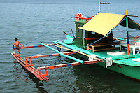 An outrigger is a part of a boat's rigging which is rigid and extends beyond the side or gunwale of a boat. The outrigger is positioned rigidly and parallel to the main hull so that the main hull is less likely to capsize. If only one outrigger is used on a vessel, its weight reduces the tendency to capsize in one direction and its buoyancy reduces the tendency in the other direction.