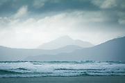 Looking over rough weather on sea in Mason Bay towards Codfish Island, The Southern Circuit, Stewart Island / Rakiura, New Zealand Ⓒ Davis Ulands   davisulands.com