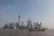 China, Shanghai. Pudong slyline view from the Bund promenade