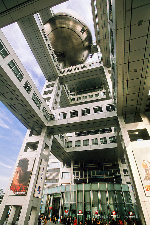 Low angle view of Fuji Television Building in Odaiba district, Tokyo city, Tokyo Prefecture, Japan. The building, designed by renowned architect Kenzo Tange, is the headquarters for Fuji Television.