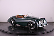 """The Junior Cars that reach speeds of 46mph and cost from £8000 up to £20,000<br /> <br /> <br /> Green Roadster starting price £9,995<br /> http://www.youtube.com/watch?v=5GvgjxKY784&feature=youtu.be<br /> <br /> This could be the ultimate toys for rich brats – unless the brat was us, and then it would be absolutely fine.<br /> <br /> Think what you might about a toy car that costs about as much a nicely equipped Mini, these  Junior Cars are absolutely amazing.<br /> <br /> Styled to look like a 1960s classics customers are free to specify the color and trim, much like they would a real Aston. The headlights, indicators, and horn are all fully-functional too.<br /> <br /> The cabin has a wood-rimmed steering wheel, while the seats can be ordered in vinyl or leather trim. If you think that's insane, then take a look at the Junior cars performance specs!<br /> <br /> This isn't some pedal-powered contraption, not by a long shot. Under the tiny hood is a 110cc gasoline-fed engine which features key-operated starting, and comes mated to a 3-speed semi-automatic transmission. According to Nicholas Mee & Co., the London-based Aston Martin dealer offering the DB Junior, this wee toy car can hustle its way to a top speed of 46 mph.<br /> <br /> Yep, Junior could just about get his first taste for highway driving in this thing! The top speed can<br /> <br /> be adjusted downwards, however.<br /> <br /> There's good news for those who are young at heart – these cars has room for a full-size adult.<br /> <br /> """"We regularly have enquiries from our clients looking for something unusual and different to add to their collection of classics,"""" said dealership manager Benja Hedlet of Pocket Classics.co.uk<br /> <br /> Specifcations<br /> <br /> In standard tune the cars reach 45mph (72 kph). This can be restricted for younger drivers. Owners may modify the cars to reach speeds in excess of 80 mph (128 kph). The cars in standard tune use approx. 1.5 litres an hour.<br /> <br /> Leng"""