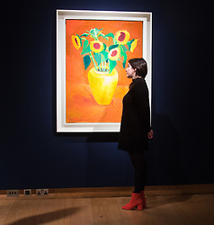 Christie's, London, March 3rd 2017. PICTURED: A woman admires David Hockney's 'Sunflowers In A Yellow Vase', painted in 1996, which is expected to fetch between £1.5-2.5 million. <br /> Fine art auctioneers Christies hold a press preview for their Post-War and Contemporary Art auctions to be held on March 7th and 8th.