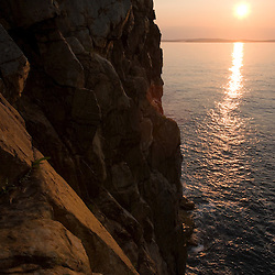 Sunrise from the cliffs of Great Head in Maine's Acadia National Park.