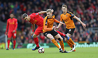 Football - 2016 / 2017 FA Cup - Fourth Round: Liverpool vs. Wolverhampton Wanderers<br /> <br /> Roberto Firmino of Liverpool and George Saville of Wolverhampton Wanderers  at Anfield.<br /> <br /> COLORSPORT/LYNNE CAMERON