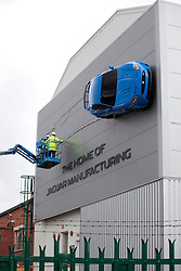 © Licensed to London News Pictures 25/09/2012. Castle Bromwich, Near Birmingham, UK. You would be forgiven thinking cars can fly if you pass by the Jaguar production plant in Castle Bromwich today. Workers are today putting the finishing touches to one of their latest cars, a two doorJaguar RS, forty feet above ground. The car, a real one, is not the only thing to take to the skies over Castle Bromwich, at the nearby traffic island, a sculpture depicts three spitfires as homage to the people who built the planes near the very spot where Jaguar today produces it's award winning cars..Photo credit : Dave Warren/LNP