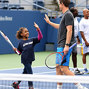 Andy Murray playing tennis with Machiella Tejada, 8, from  from Rockaway, Queens. Reigning US Open champions Andy Murray and Serena Williams took part in the Tennis clinic with local Queens kids affected by Hurricane Sandy. Flushing. New York, USA. 22nd August 2013. Photo Tim Clayton