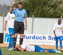 Morton's Doug Imrie after colliding with ref Craig Thomson.<br /> Falkirk 3 v 1 Morton, Scottish Championship 17/8/2013.<br /> ©Michael Schofield.