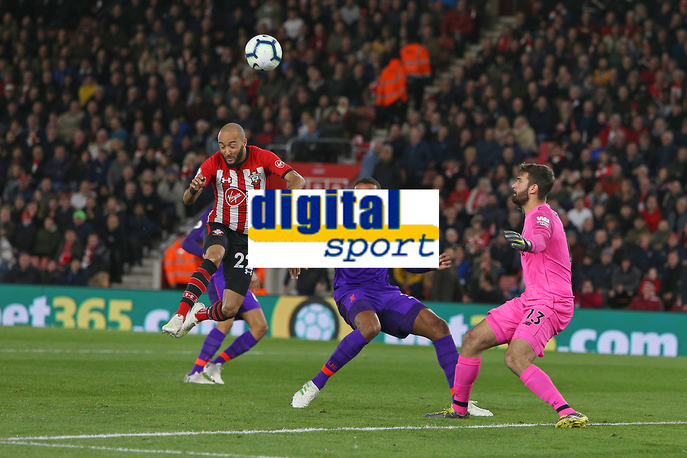Football - 2018 / 2019 Premier League - Southampton vs. Liverpool<br /> <br /> Southampton's Nathan Redmond ducks out of a challenge from Alisson of Liverpool during the Premier League match at St Mary's Stadium Southampton <br /> <br /> COLORSPORT/SHAUN BOGGUST