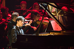 Painist Ji Liu performs with The Bournemouth Symphony Orchestra, conducted by Pete Harrison, at Classic FM Live, at the Royal Albert Hall in London. The concert was part of Classic FM's 25th Birthday celebrations. Picture date: Tuesday September 19th, 2017. Photo credit should read: Matt Crossick/ EMPICS Entertainment.