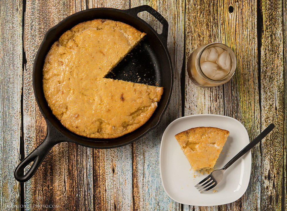 Cornbread in a cast iron skillet with butter for a meal