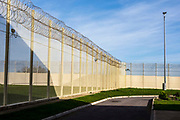 Security fencing. HMP/YOI Portland, a resettlement prison with a capacity for 530 prisoners. Dorset, United Kingdom.
