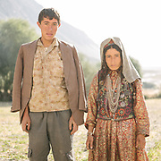 Bakh Shoh (left) and his relative. They are about to go in the field for work, wearing their everyday cloth. In Wakhan, work tasks are interchangeable, there is equality between sexes, that's mainly due to the fact that here everyone is Ismaili, a branch of Islam that is very liberal whose spiritual leader is the Aga Khan – a multimillionaire, Harvard graduate living in Europe.