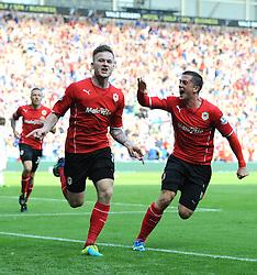 Cardiff City's Aron Gunnarsson celebrates his goal to make it  1-1  - Photo mandatory by-line: Joe Meredith/JMP - Tel: Mobile: 07966 386802 25/08/2013 - SPORT - FOOTBALL - Cardiff City Stadium - Cardiff -  Cardiff City V Manchester City - Barclays Premier League