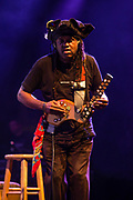 "3 August 2017 – Brooklyn, NY. Singer Nellie McKay opened for Béla Fleck and the Flecktones to a large crowd at the BRIC Celebrate Brooklyn! Festival at the Prospect Park Bandshell. The Flecktones' percussionist Roy ""Future Man"" Wooten on a drumitar, a keyed drum synthesizer shaped like a guitar."