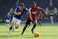 Seamus Coleman of Everton (l) and Saido Berahino of West Bromwich Albion battle for the ball. Barclays Premier League match, Everton v West Bromwich Albion at Goodison Park in Liverpool on Saturday 13th February 2016.<br /> pic by Chris Stading, Andrew Orchard sports photography.