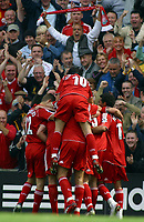 Photo: Paul Thomas.<br /> Liverpool v West Ham United. The Barclays Premiership. 26/08/2006.<br /> <br /> Daniel Aggar and Liverpool celebrate his goal.