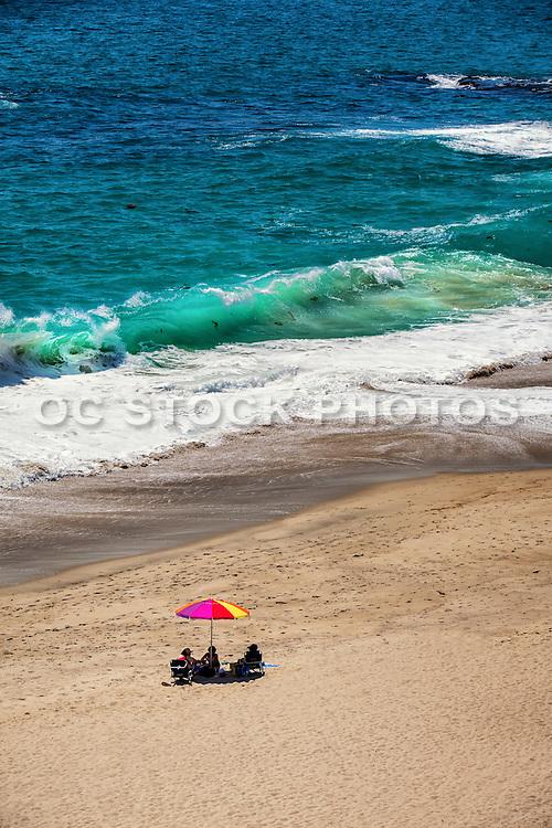 Laguna Beach Locals Sitting on the Sand at Table Rock Beach