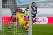 Newcastle United goalkeeper Karl Darlow (26) saves during the Premier League match between Newcastle United and Leeds United at St. James's Park, Newcastle, England on 26 January 2021.
