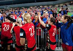Alja Koren, Sanja Gregorc, Alja Jankovic and Iris Guberinic  of Krim celebrate with their fans Krimovci after winning the handball match between RK Krim Mercator (SLO) and RK Podravka Vegeta (CRO) in Women's EHF Champions League, on November 13, 2010 in Arena Stozice, Ljubljana, Slovenia. Krim defeated Podravka 26:22 and qualified to Main Round of Champions League. (Photo By Vid Ponikvar / Sportida.com)