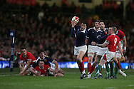 Francois Trinh-Duc of France collects a wayward Welsh pass and his on his way to scoring the second French try. RBS Six nations, Wales v France at the Millennium Stadium in Cardiff on Friday 26th Feb 2010. pic by  Andrew Orchard , Andrew Orchard sports photography,