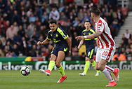 Alexis Sanchez of Arsenal (l)  in action . Premier league match, Stoke City v Arsenal at the Bet365 Stadium in Stoke on Trent, Staffs on Saturday 13th May 2017.<br /> pic by Bradley Collyer, Andrew Orchard sports photography.