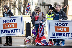 © Licensed to London News Pictures. 14/02/2019. London, UK. Pro-Brexit demonstrators during a protest opposite Downing Street. MPs continue to debate Brexit in Parliament, and will vote on a series of amendments today. Photo credit: Rob Pinney/LNP