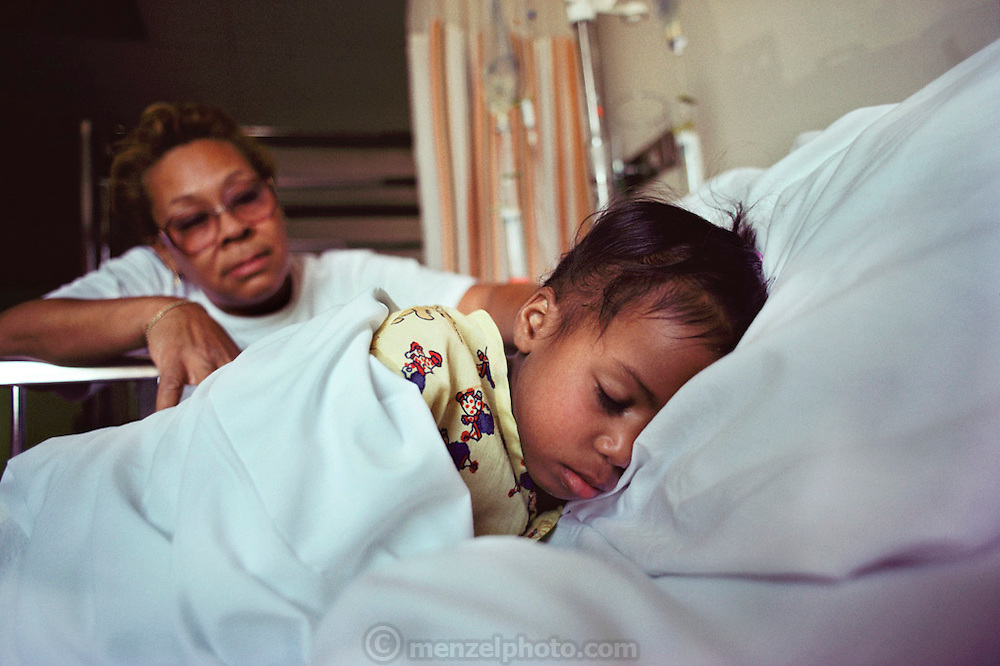 (1992) In the New Jersey Children's hospital, Jean Givens sits with her adopted daughter, Cynthia, who has AIDS. Tests done with DNA amplification can immediately tell the presence of the virus. DNA Fingerprinting. MODEL RELEASED