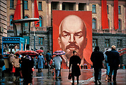 """Founder of the Soviet state, Vladimir Lenin looms over passersby on Lubyanka Square in central Moscow. During the Cold War, the yellow brick Lubyanka building was the headquarters of the KGB secret police and foreign intelligence service. """"The Lubyanka,"""" as it was ominously called, also was an infamous prison that held thousands of Russians considered """"enemies of the people,"""" as well as captured Western spies.  © Steve Raymer/National Geographic Creative"""