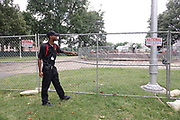 Armed security stood by as workmen remove a pedestal, on June 2, 2021, that once held a statue of Confederate general and early member of the Ku Klux Klan (KKK), Nathan Bedford Forrest. The statue, that was removed after protests in December 2017, stood over his grave in Health Sciences Park in Memphis, Tennessee, U.S. The remains of Forrest and his wife below the base will be moved to Columbia, Tennessee.