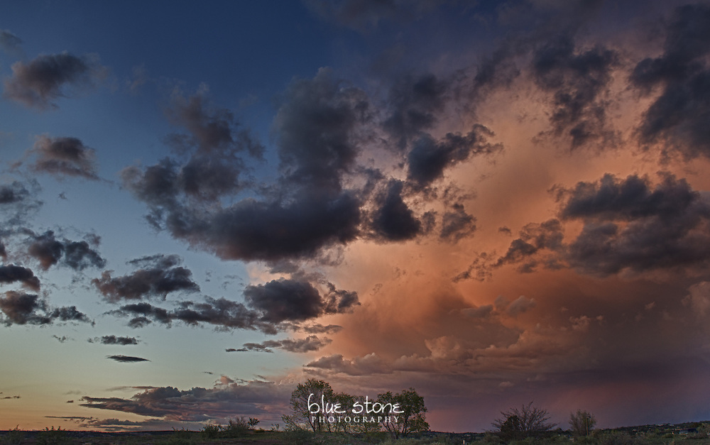 An ocean of water drops in summer monsoon clouds are painted by the sunset with coral, blue and pink.<br /> <br /> Wall art is available in metal, canvas, float wrap and standout. Art prints are available in lustre, glossy, matte and metallic finishes.