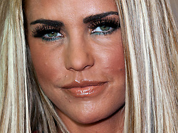 Katie Price poses before signing copies of her latest book 'Santa Baby' for fans, at Asda in Mansfield, Nottinghamshire.