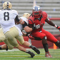 10 November 2012: Army Black Knights right tackle Michael Kime (78) blocks Rutgers Scarlet Knights linebacker Khaseem Greene (20) out of Army Black Knights quarterback Trent Steelman's (8) rushing lane during NCAA college football action between the Rutgers Scarlet Knights and Army Black Knights at High Point Solutions Stadium in Piscataway, N.J..